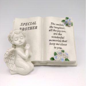 cherub memorial book brother grave ornament at beechmount garden centre