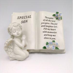 cherub memorial book son grave ornament at beechmount garden centre