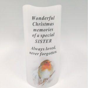 candle sister grave ornament at beechmount garden centre